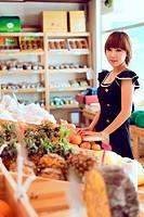 Beautiful girl stood next to fruit baskets
