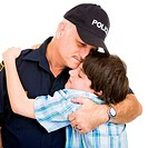 Policeman hugging an adolescent boy. Isolated on white.