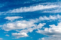 Beautiful cumulus clouds against a blue sky
