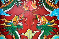 Colorful historic paintings of dragon on the red door