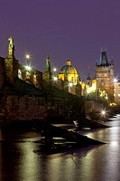 czech republic prague _ charles bridge and spires of the old town at dusk