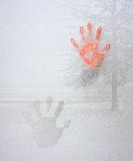 Icy Cold Hand Impression on Window Glass