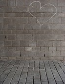 hand drawn white chalk love hearts on a grungy tiled wall