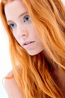 Closeup facial portrait of natural redhead beauty.