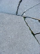 split crack in gray stone concrete surface