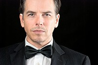 Close_up of a confident man in a tuxedo