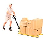 Full length portrait of a manual worker pushing a fork pallet truck isolated against white background