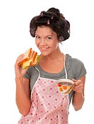 Beautiful cooking woman in apron with sandwich.Studio, white background.