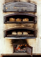 bread and dough in traditional wood oven