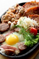 meat with egg and slapjacks in pan