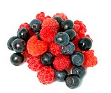 berries of raspberry and bilberry on white background