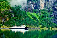 Ferry in the Geiranger fjord, listed as a UNESCO World Heritage Site