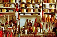 Classic handyman´s workshop, with vintage hand tools and well_organized tins of nails, screws, etc.