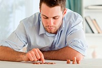 Young businessman counting his small change