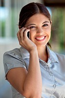 Portrait of smiling female executive talking on cell phone