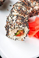 Closeup of Sushi rolls at plate with sesame