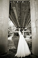 attractive girl standing under bridge. olutdoor shot