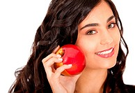 Beautiful woman holding an apple and smiling _ isolated over white