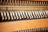 Piano hammers and strings, antique piano, closeup