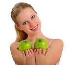 beautiful healthy girl holding a two green apple isolated on white background