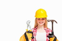 Woman smiling while wearing a safety helmet against white background
