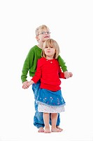 children - portrait of brother and sister standing, holding hands - isolated on white