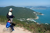 Shek o Country park DRAGONS BACK HONG KONG Chinese man and boy on footpath overlooking Big Wave Bay