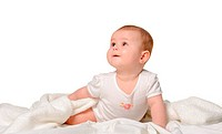 The baby on a bedsheet. Age of 8 months. It is isolated on a white background