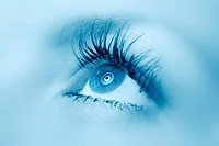 Female eye close up. A blue tonality. Selective focus