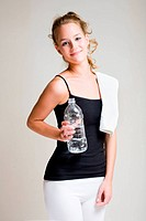Portrait of attractive young woman with bottled water.