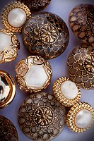 A group of golden vintage buttons. Haberdashery, creativity.