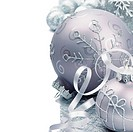 Christmas balls on the festive silver background
