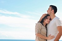 happy young couple in love have romance relax on balcony outdoor with ocean and blue sky in background