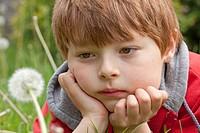 Little boy looking at a blowball