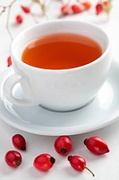 Rose hip tea in white cup closeup
