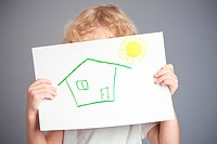 Drawn sun and house in baby hands. Spring concept
