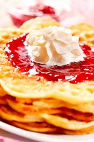 Waffles with fresh strawberry jam