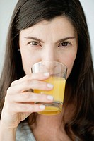 Mid_adult woman drinking orange juice
