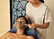 Woman getting facial herbal mask                                                                                                                      ...