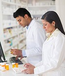Two pharmacists in pharmacy