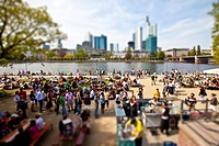 Young people on the Main river, behind the Financial District, miniature view, tilt-shift effect, reduced depth of field, Frankfurt am Main, Hesse, Ge...
