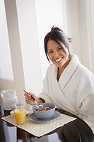 Woman having cereal for breakfast