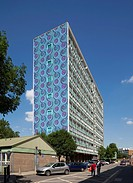 Yinka Shonibare art installation ´Wall 2010´ Sceaux Gardens Camberwell London UK patterned mural draped over a tower block and people on the street lo...