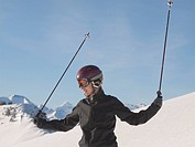 Young woman in ski gear at top of mountain