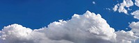 Panoramic view of fluffy spring clouds with copy space