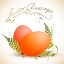 Easter greeting theme with eggs and green fern