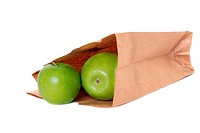 Brown paper bag with green apples isolated