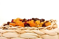 Mixed Dried Fruits of Apricots, sultana, raisins and cranberries in wicker basket.