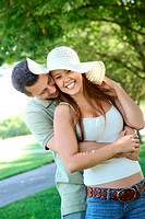 Attractive man and woman couple in love in the park