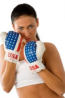 Attractive woman with usa flag boxing gloves keeping up guard